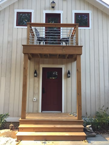 Front door with digital key pad lock for self-checkin and balcony with bistro set.