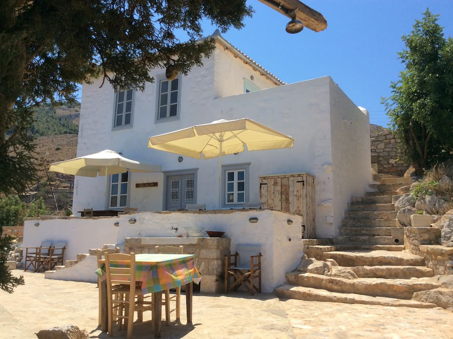 Beautifully managed rural outside, transforms to cool deluxe comfort inside at Nicaela's house to rent on Hydra Island Greece.