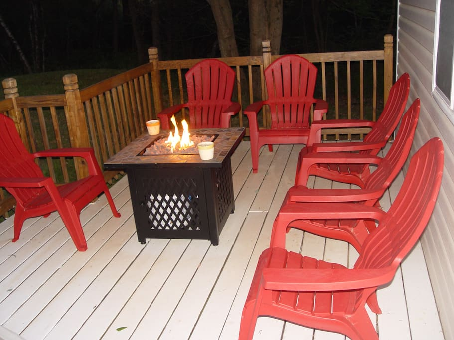 Deck equipped with fire pit and comfortable chairs - great for outdoor entertainment!