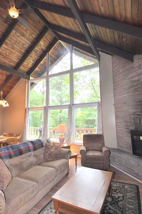 A Lovely Living Space. The large chalet windows keep the living area well lit and comfortable.