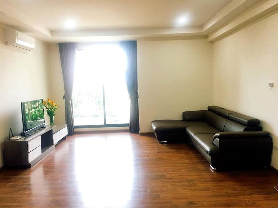 a part of living room with sofa, a balcony