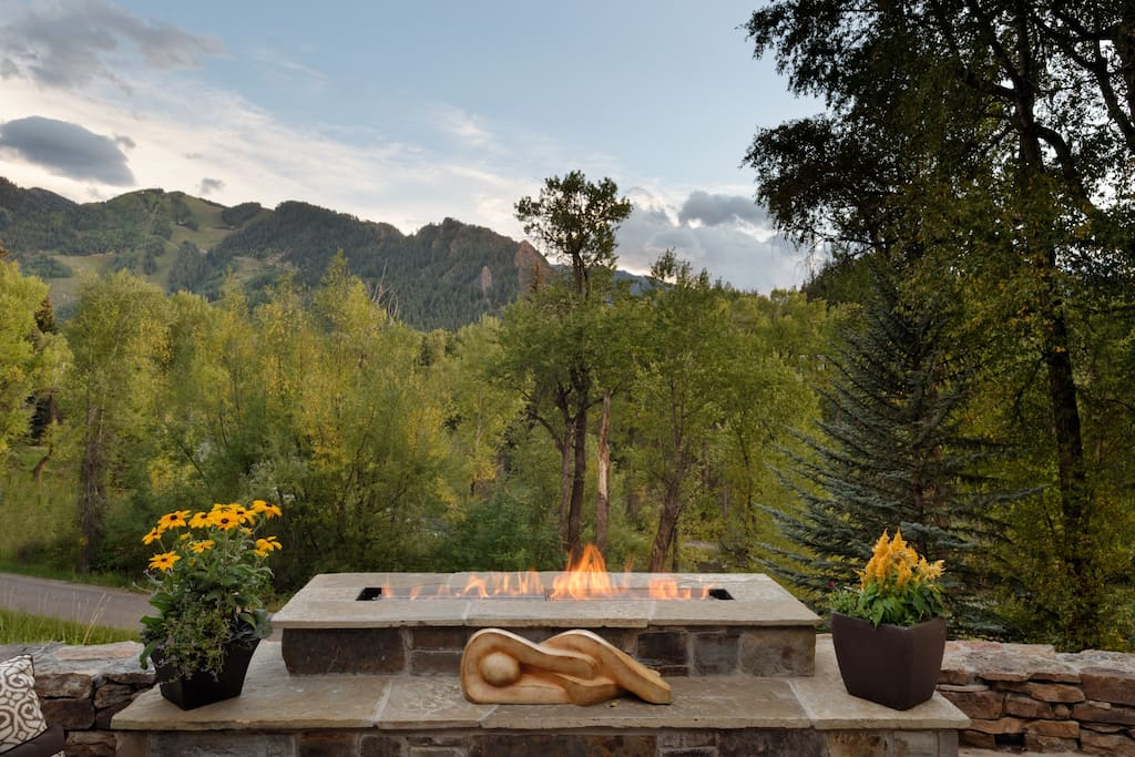 Custom-designed fire feature overlooking Aspen mountain and the Roaring Fork River.