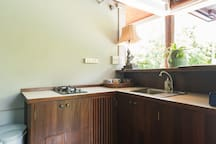 Kitchenette, with gas cooker, fridge, sink and bar.