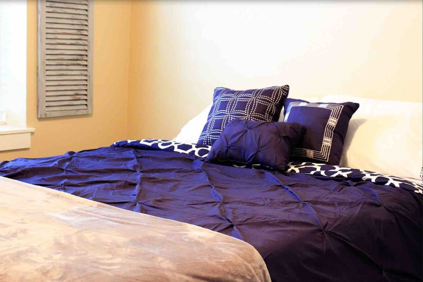 Queen bed with extra throw.