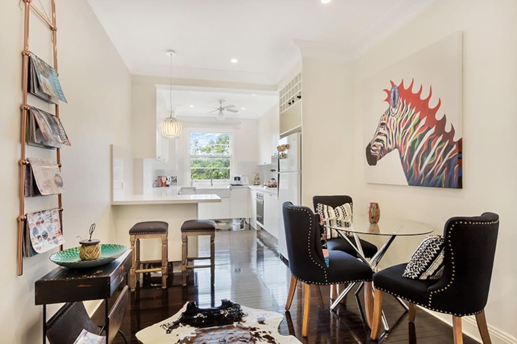 Separate dining room with open plan kitchen, breakfast bar. Two beautiful rosellas will sing to you every morning from the trees outside the kitchen window.