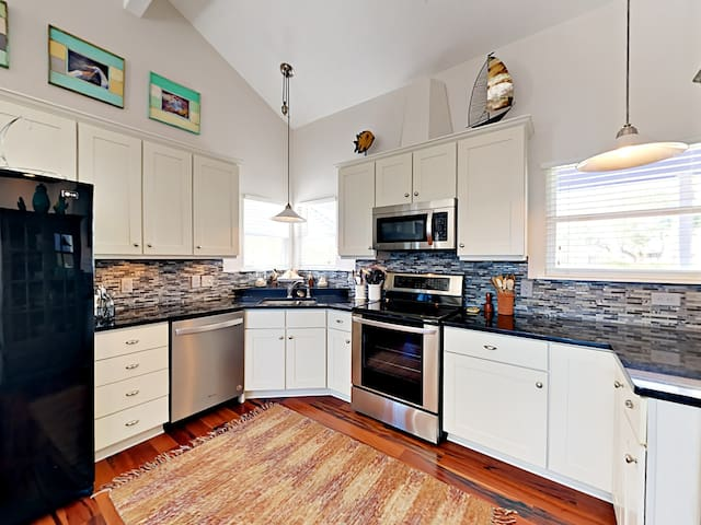 Whip up dinner in the kitchen, outfitted with granite countertops, upgraded appliances, and a tile backsplash.