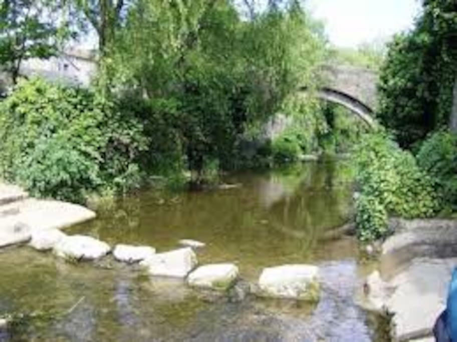 river, packhorse bridge and stepping stones