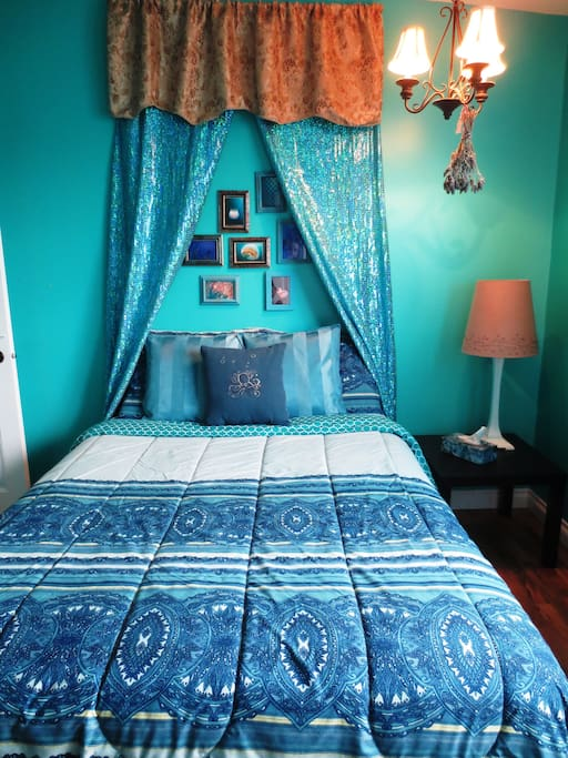 Your room with mermaid themed decor comes with a double bed, desk and seating for two