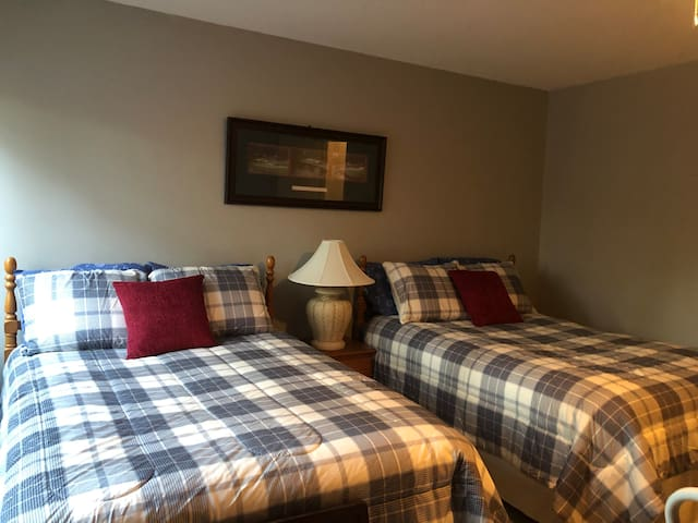 Upstairs guest bedroom, 2 full beds, 36 in tv and access to hall bath