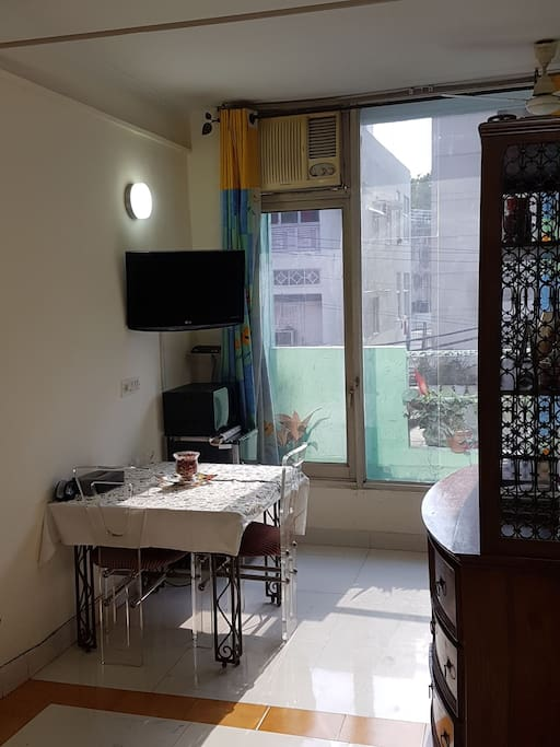 Dinning area is equipped with TV, Microwave, fridge and a window AC.