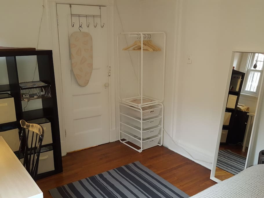 Hangers and storage for clothes. Full length mirror.