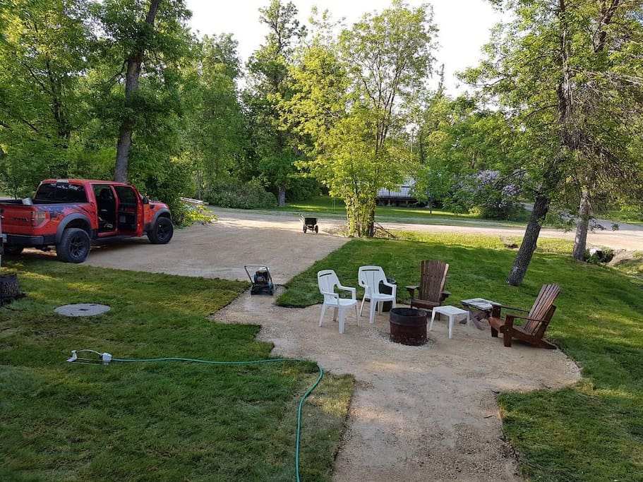 Backyard re-landscaped June 2017 with new sod and new larger gravel parking pad and fire pit area.
