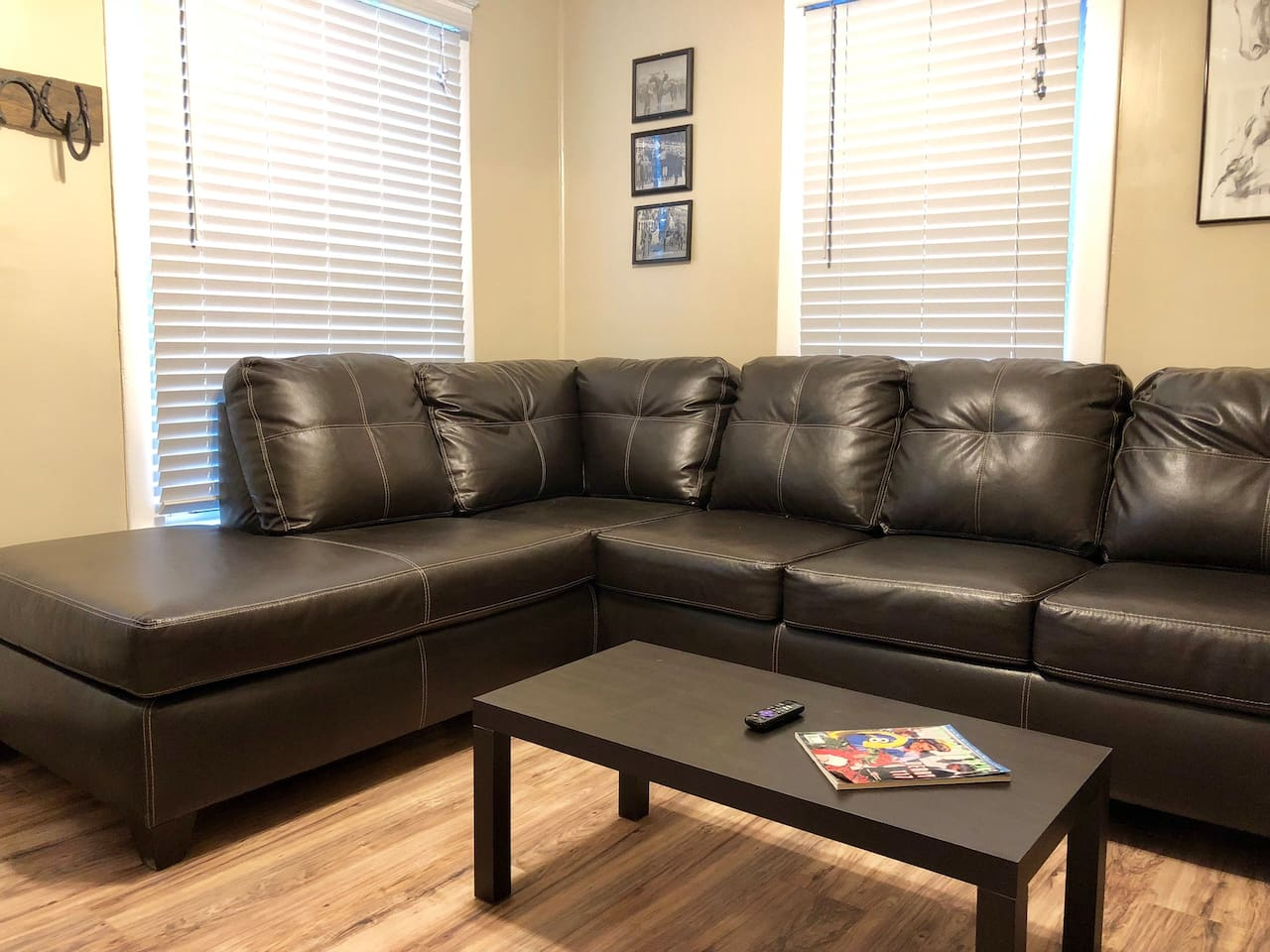 Living room with sectional couch that doubles as a bed for 1 person if needed.