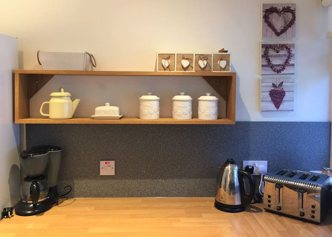 Kitchen corner with small appliances.