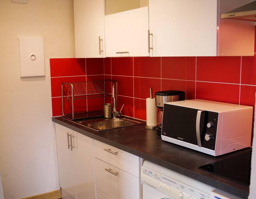 Une cuisine neuve et toute équipée pour préparer de bons p'tits plats !