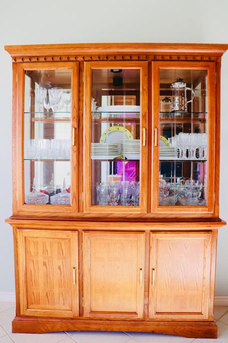 The china cabinet is full of silverware and more. Located in the spacious kitchen.