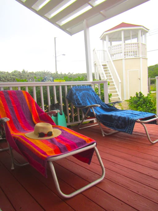 The front porch is a great space to stretch out and enjoy the fresh sea breezes