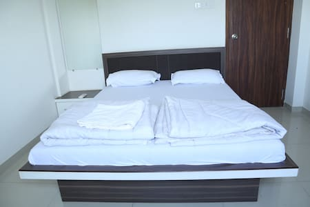The SSK Service Apartments Room - Nashik