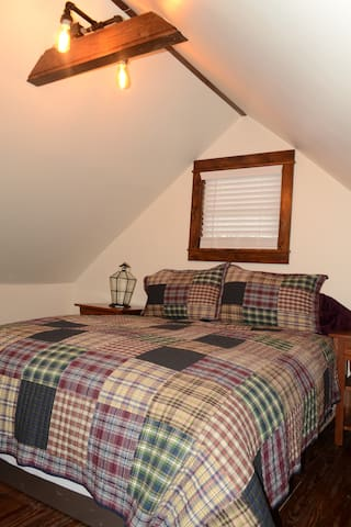 Loft bedroom-watch out for low ceilings!