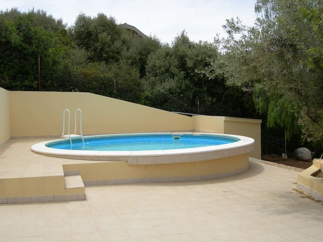 Semi-detached house with small pool