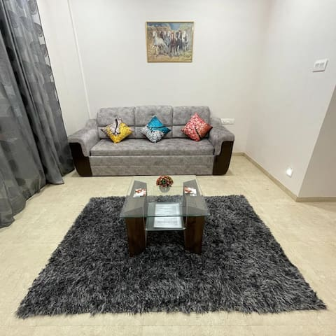 Living room space with sofa convertible into sofa cum bed