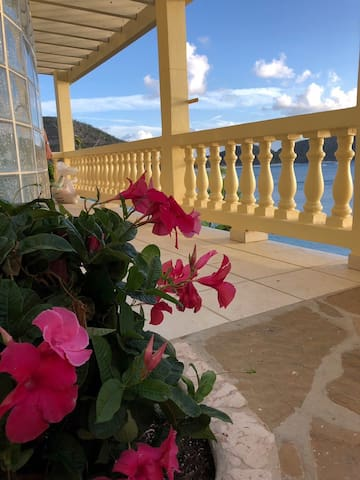 This is the entrance to the Caribe 3 King Suite with a 4-Poster bed, kitchenette, couch, outdoor patio, and al fresco shower. Heavenly views!