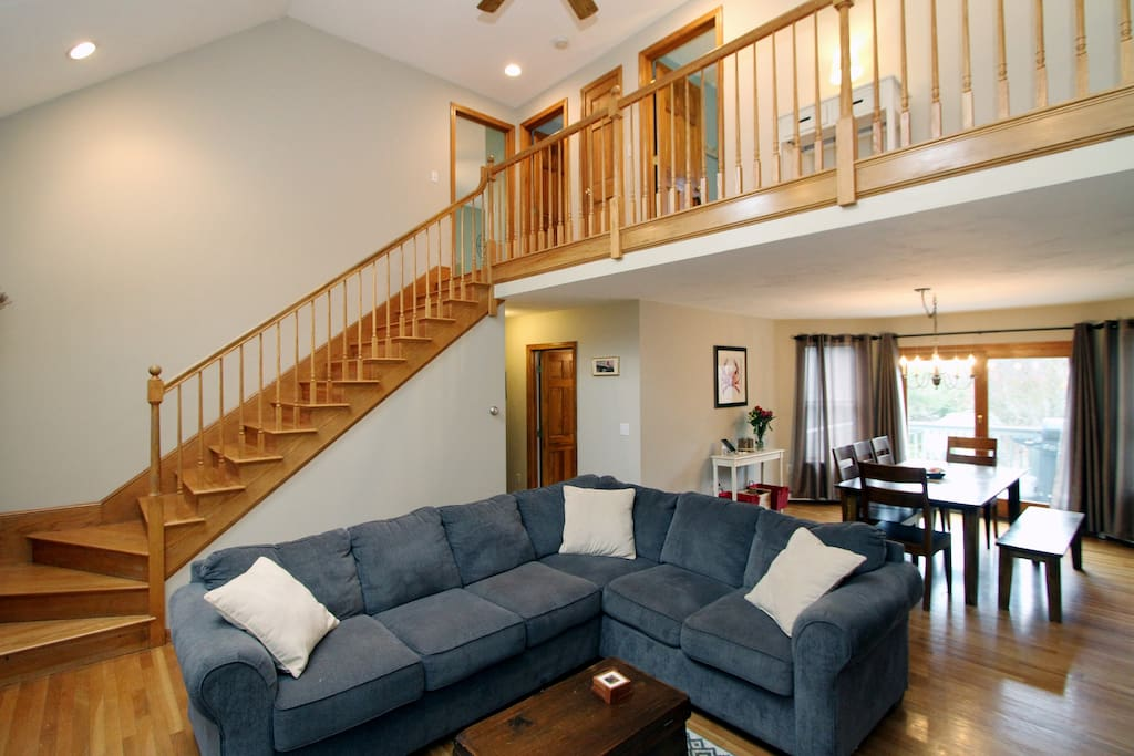 A sweeping staircase up to the 2nd floor in the main living area