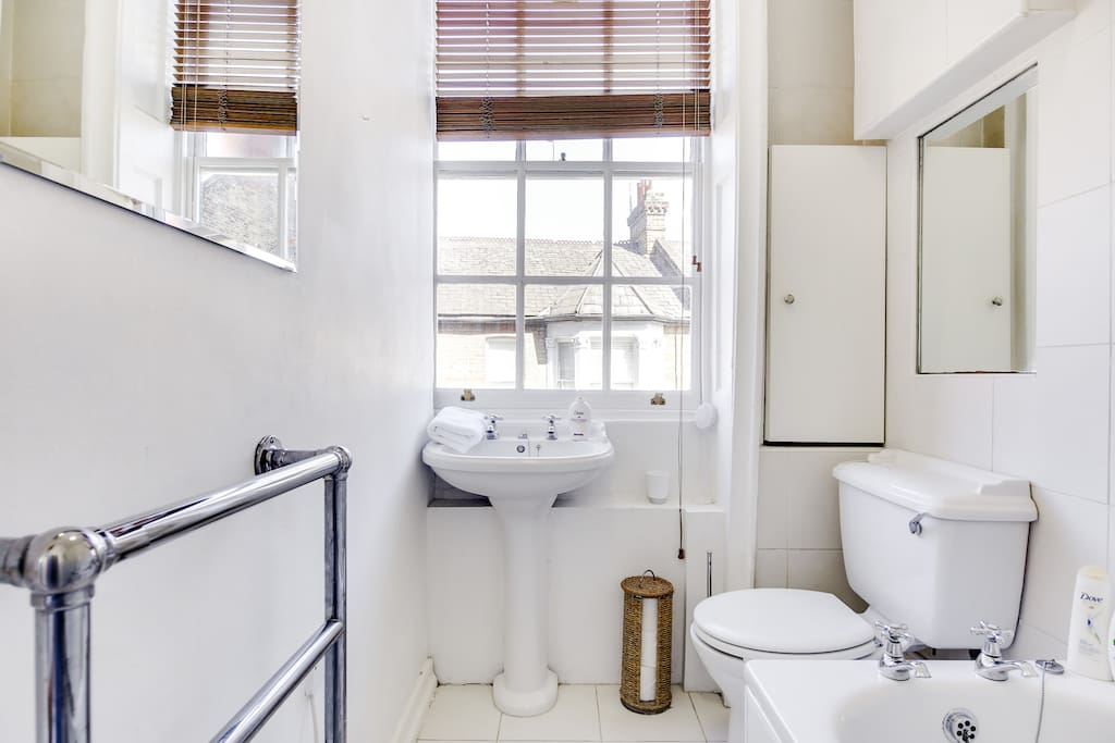 A bathroom with towels and toiletries provided...