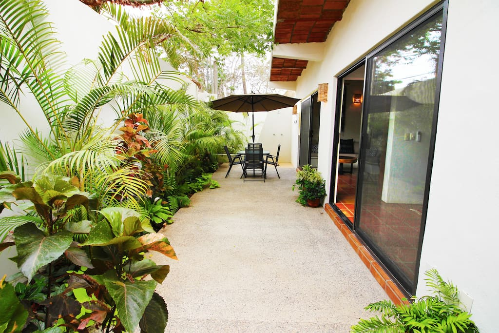 Large private patio with dining table and outdoor shower