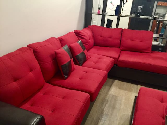 Couch in modern furnished apartment