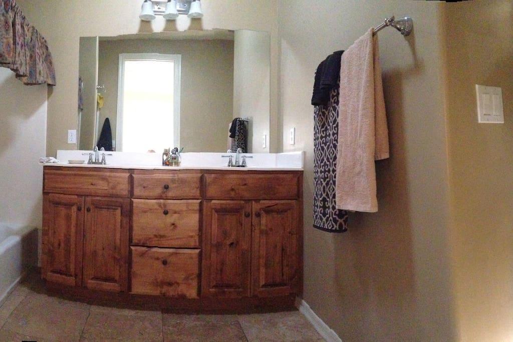 Master bath has 2 sinks, bath & shower