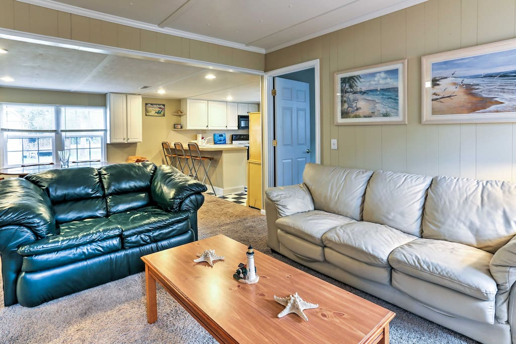 After a long day of traveling, sit back and relax on the 2 leather couches.