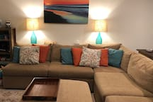Sectional/pit couch seating for watching projection HDTV or playing games