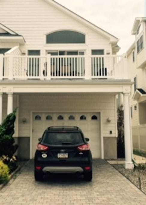Accommodates one vehicle in the garage, one outside, one to the right, and a 4th can block our driveway if needed.