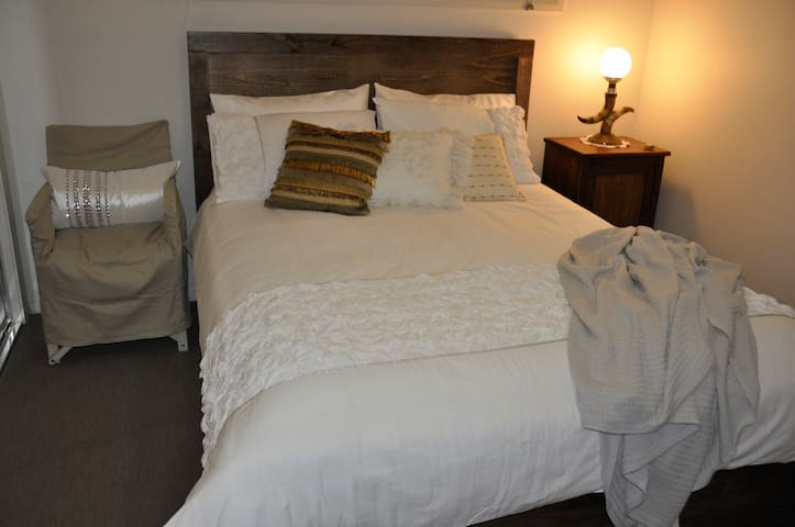 Bedroom 4 featuring queen bed, electric blanket, ceiling fan, built in wardrobe, bath robes and chest of drawers for storage.