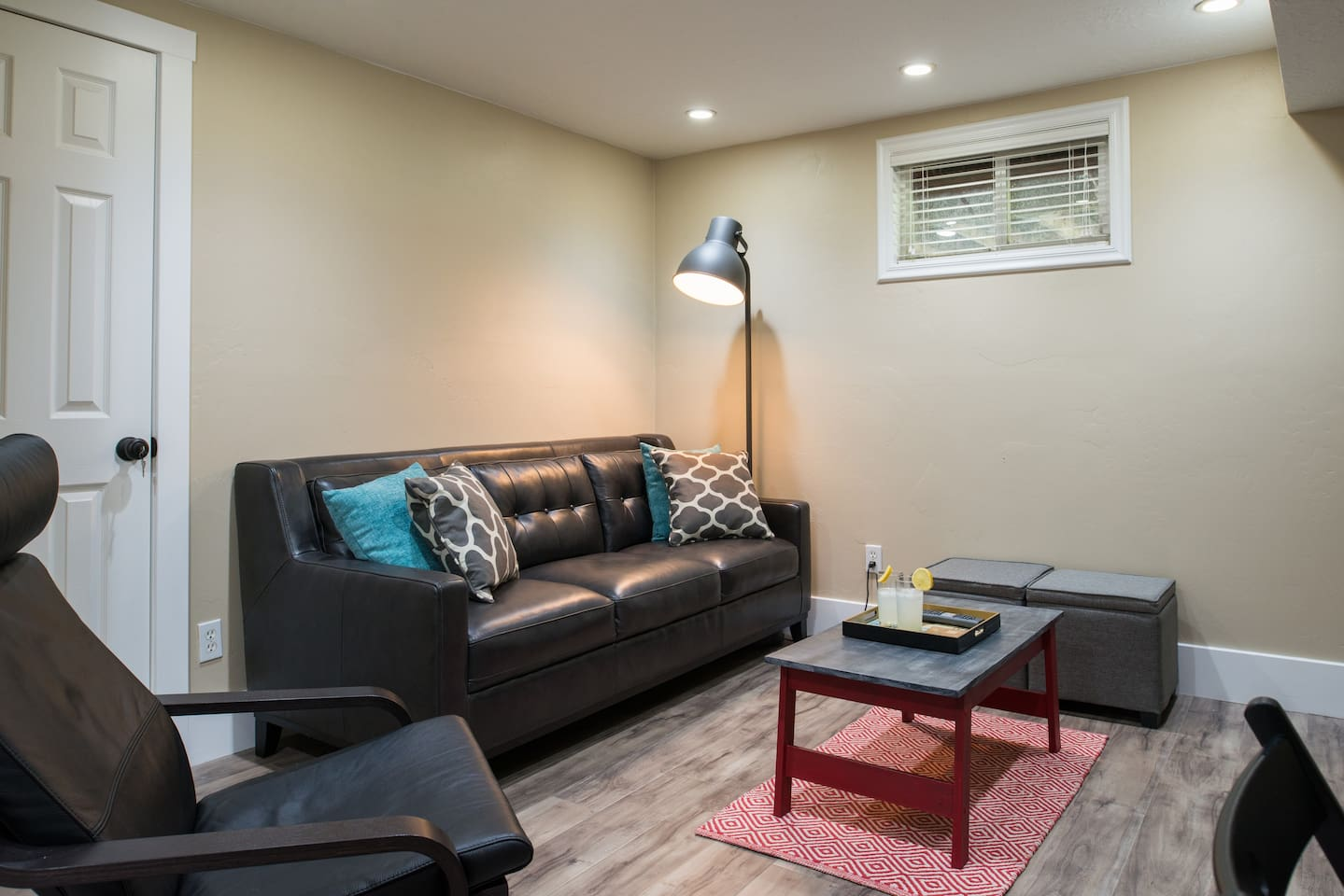 Living room with real leather couch and very comfy real leather chair.