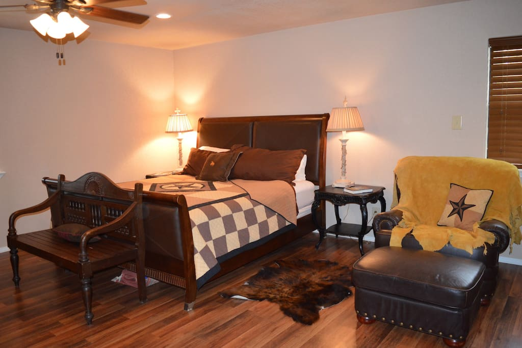 Spacious master bedroom with king bed, sleeper couch and 2 dressers