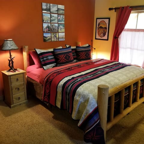 King bed, ensuite bathroom, tub & shower. Has a large ceiling fan with remote controlled operation.