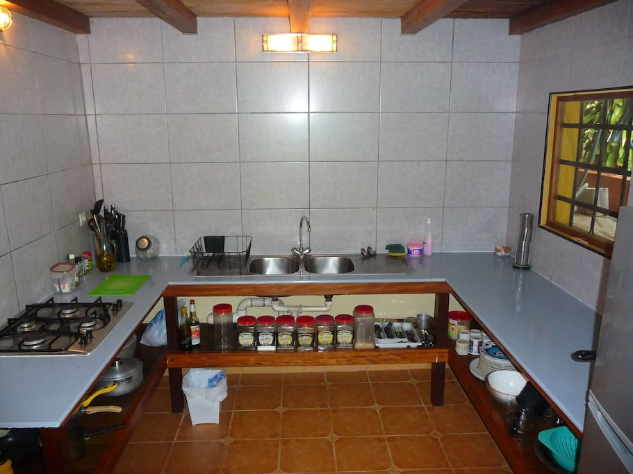 The kitchen is small, but fully equipped with fridge freezer, stove, pots, pans and much more.
