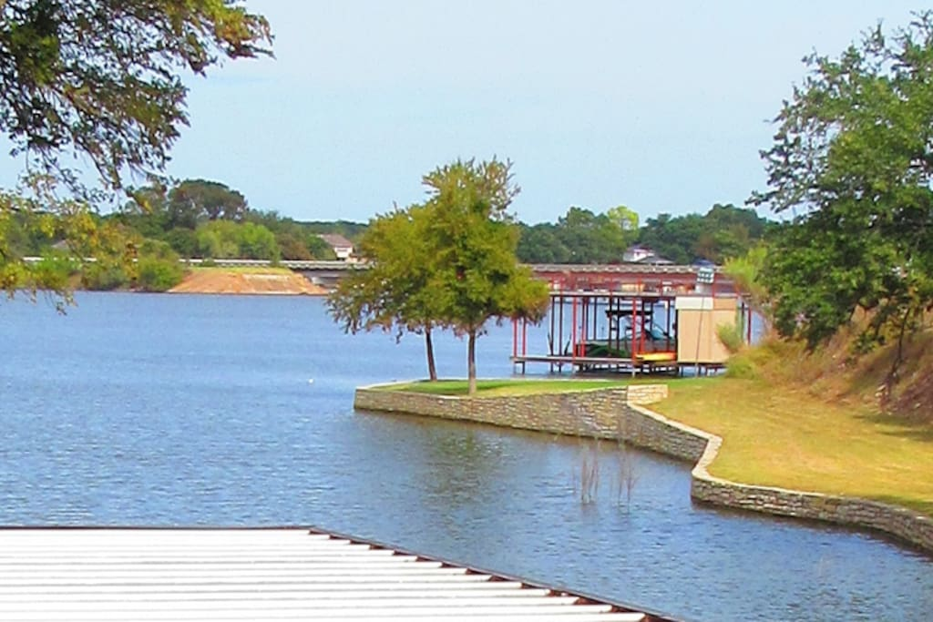Secluded lake house w 2 story boat dock trees houses for 2 story lake house