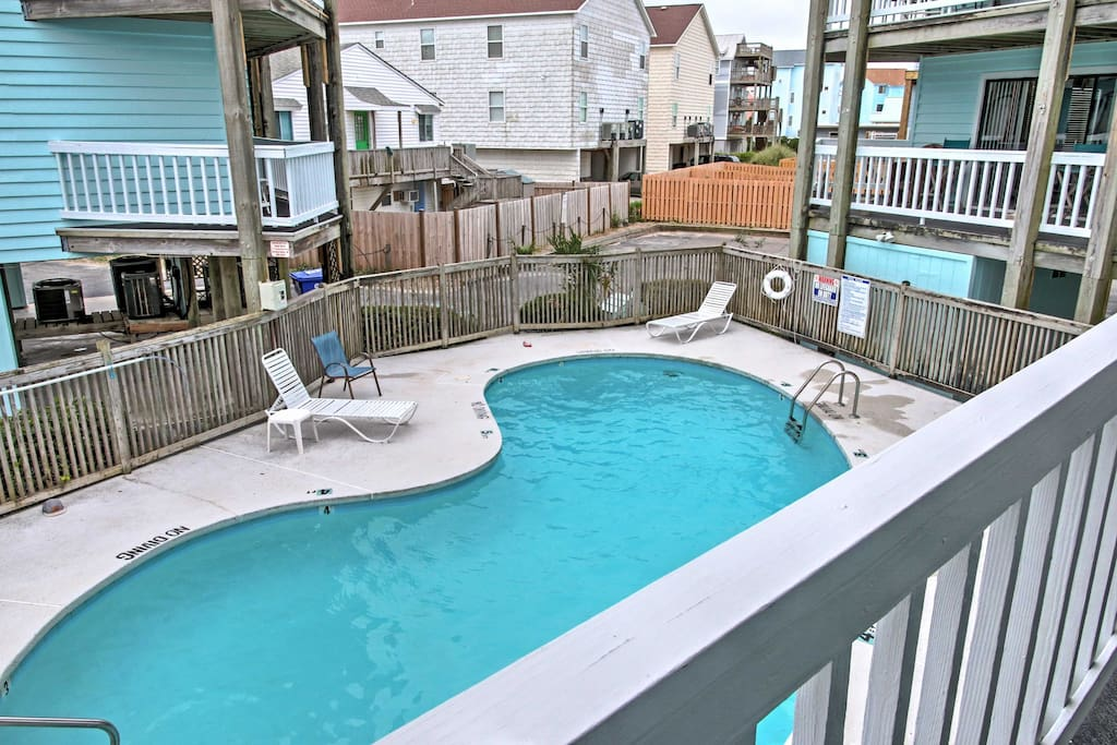 Spend days lounging by the pool during your stay at this Carolina beach vacation rental condo.