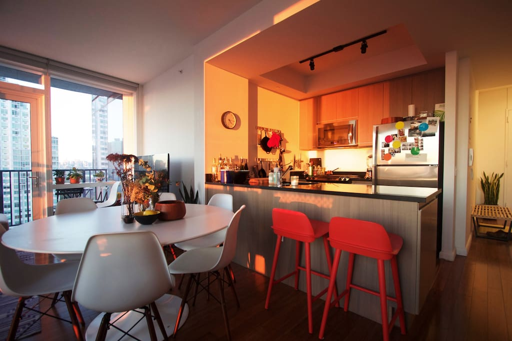 Fully equipped kitchen with dishwasher and bar stools—a great spot for breakfast.