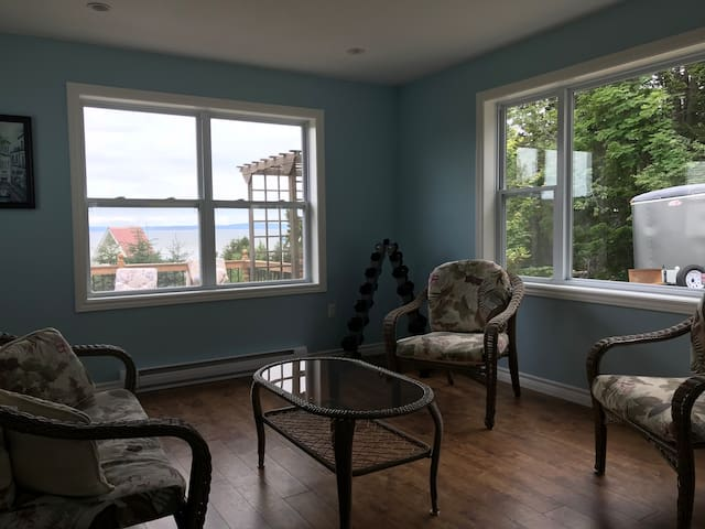 The sitting room doubles as a third bedroom, with a queen air bed. Room darkening blinds are being installed.