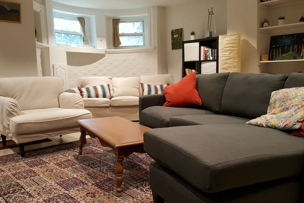 Large open space living room with two couches, television, chair
