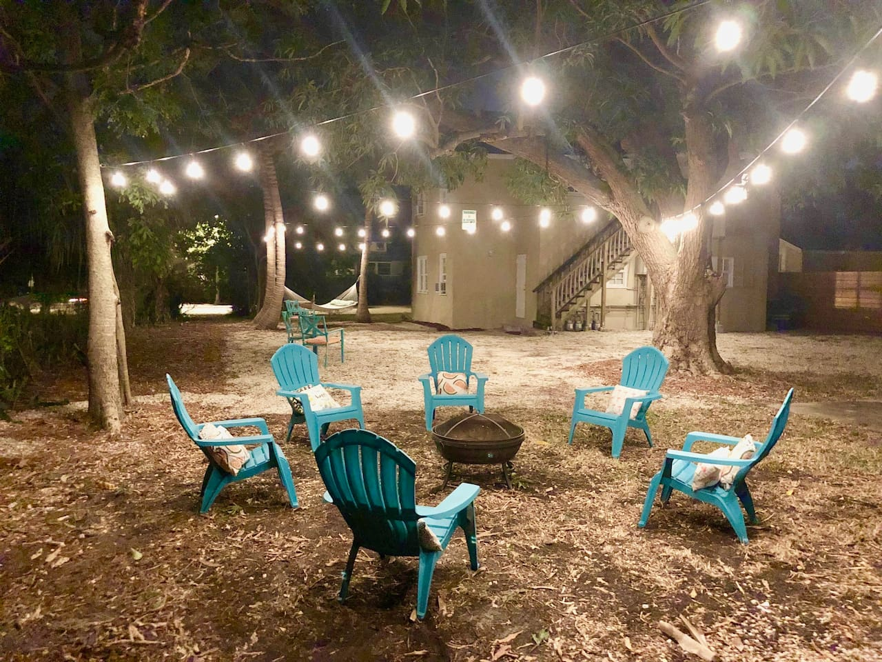 Cozy outdoor space with firepit!  Edison bulb lights included to help set the mood.