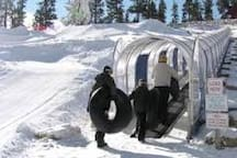 Inner tube snow sliding at Alpine Slide at Magic Mountain is 0.3 mile from the cabin.