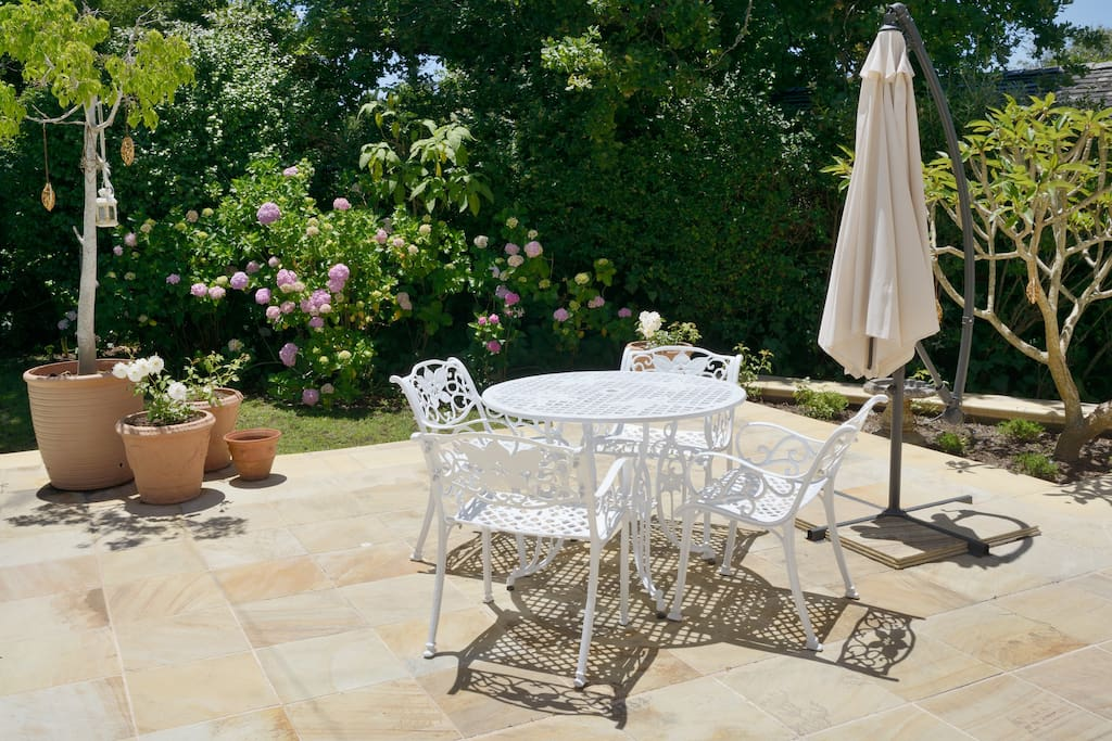 Gorgeous wrought iron table and chairs alongside the pool for having breakfast or enjoying drinks outside
