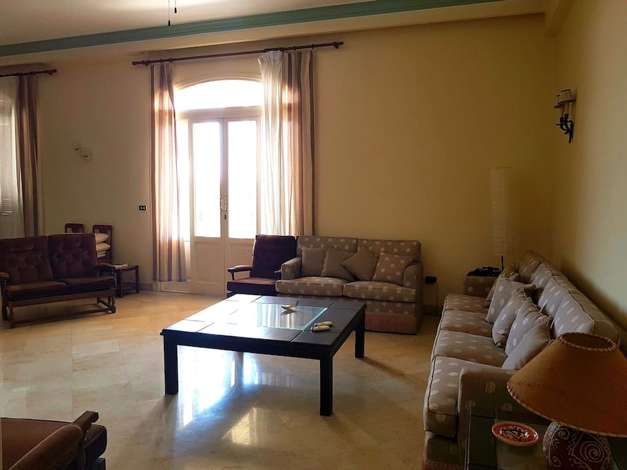 Spacious living room from the main entrance view with a large terrace overlooking the garden