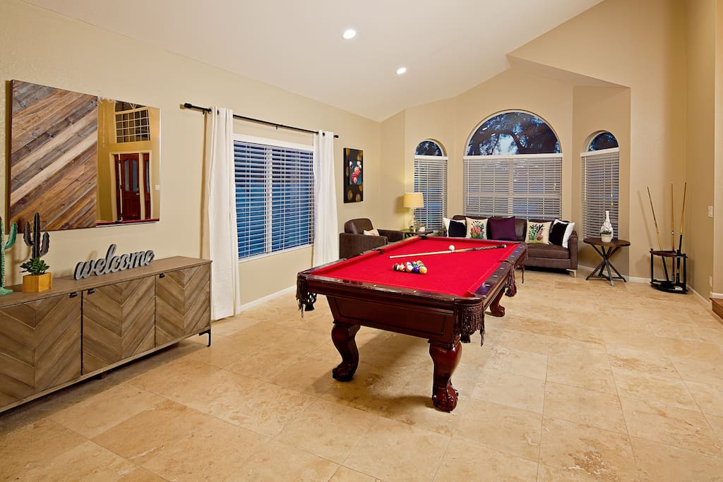 Bright and open game room with fun pool table.