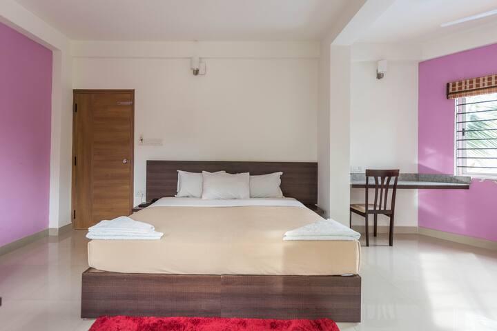 Jade AC Deluxe Room, Ebenezer Suites, Whitefield
